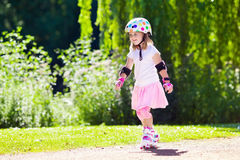 Little girl with roller skate shoes in a park Stock Image