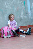 Little girl with roller skates Stock Image
