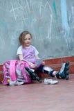 Little girl with roller skates Stock Image