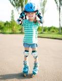 Little girl in roller skates Royalty Free Stock Photos