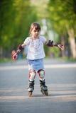 Little girl on roller skates Stock Photography