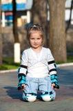 Little girl in roller skates Stock Photography