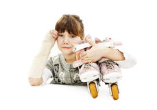 Little Girl with roller skates and broken arm Royalty Free Stock Photography