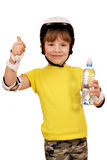Little girl with roller skates equipment and thumb up Stock Photo