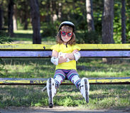 Little girl with roller skates Royalty Free Stock Image