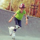 Little girl on roller skates Stock Images
