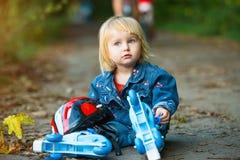 Little girl on roller skates Stock Photo