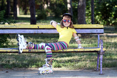 Little girl with roller skates and helmet Stock Photos