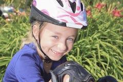 Little girl in roller skates at a park Stock Photos