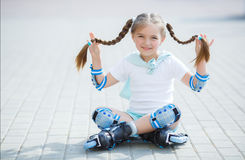 Little girl on roller skates in park. Stock Image