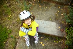 Little girl in roller skates at a park Stock Photo
