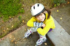 Little girl in roller skates at a park Stock Photos