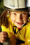 Little girl in roller skates at a park Stock Image