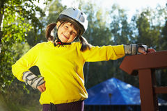 Little girl in roller skates at a park Royalty Free Stock Photos