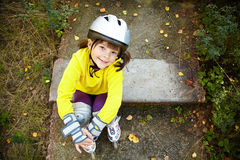Little girl in roller skates at a park Royalty Free Stock Images