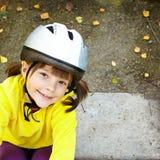 Little girl in roller skates at a park Stock Photo