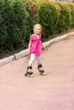 Little girl on roller skates at park Stock Images