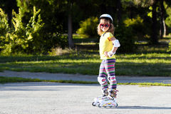 Little girl with roller skates Royalty Free Stock Photos