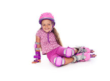Little girl with roller skates resting Royalty Free Stock Photo