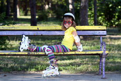 Little girl with roller skates Stock Photo