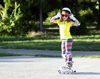 Little girl with roller skates Royalty Free Stock Photography