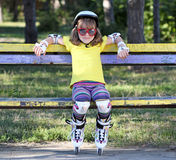 Little girl with roller skates Stock Photos