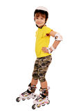 Little girl with roller skates on white Stock Photography