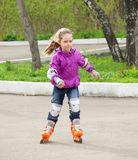 Little girl roller-skating Royalty Free Stock Image