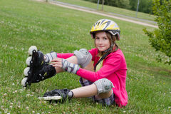 Little girl rolller skating in a park Royalty Free Stock Photography