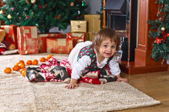 Little girl  in the room with Christmas decorations Stock Images