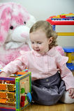 Little girl in a room with toys Stock Photo