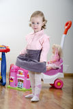 Little girl in a room with toys Royalty Free Stock Photo