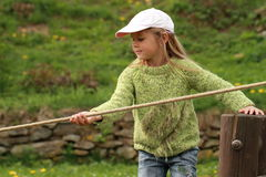 Little girl with a rope. Little girl playing with a rope stock photos