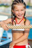 Little girl with a rope Royalty Free Stock Images