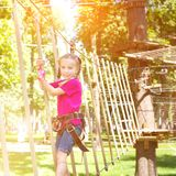Little girl  in a rope park Stock Image