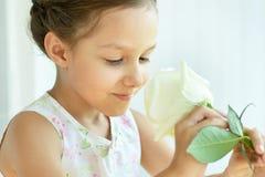 Little girl with  rose flower Stock Image