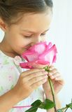 Little girl with  rose flower Stock Photos