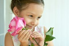 Little girl with  rose flower Royalty Free Stock Photography