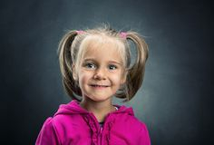 Little girl in rose jacket smiling Royalty Free Stock Photo