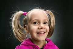Little girl in rose jacket smiling Stock Photography