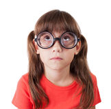 Little girl in round spectacles Royalty Free Stock Photos
