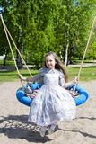 Little girl on the round swings posing Royalty Free Stock Photo