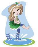Little girl in rubber boots Stock Images