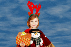 Little girl with rudolf deer horn and gift Stock Photos