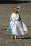 Little girl run Stock Image