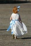 Little girl run. Ning Stock Image