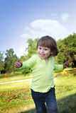 Little girl run in park Stock Image
