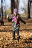 Little girl  run in park. Stock Images
