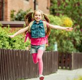 Little girl  run from school Stock Image