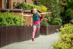 Little girl  run from school Stock Photography